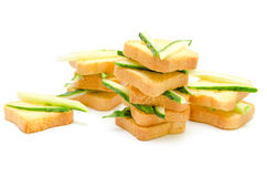 Dietary breakfast of small breads and cucumbers. Diet appetizer with small crispy toasts and cucumbers royalty free stock images