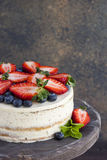 Dietary cake with berries on a wooden tray. Delicious, useful. Royalty Free Stock Images