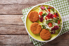 Dietary carrot cutlets and salad of chicory, cabbage and tomatoe Royalty Free Stock Images