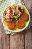 Dietary carrot cutlets and salad of chicory, cabbage and tomatoe Royalty Free Stock Photo