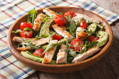 Dietary chicken salad with avocado, arugula and cherry tomatoes Stock Photos