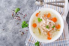 Dietary chicken soup with rice and carrots. Healthy food. Flat lay. Top view Royalty Free Stock Photos