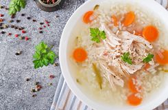 Dietary chicken soup with rice and carrots. Healthy food. Flat lay. Top view Royalty Free Stock Image