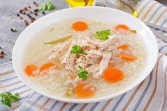 Dietary chicken soup with rice and carrots. Healthy food. Dietary chicken soup with rice and carrots on the light backgound. Healthy food Royalty Free Stock Photo
