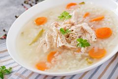 Dietary chicken soup with rice and carrots. Healthy food. Dietary chicken soup with rice and carrots on light background. Healthy food Royalty Free Stock Images
