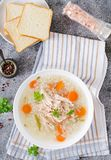 Dietary chicken soup with rice and carrots. Healthy food. Flat lay. Top view Stock Photo