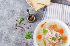 Dietary chicken soup with rice and carrots. Healthy food. Flat lay. Top view Stock Images