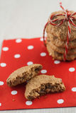 Dietary cookies with dried fruits on red napkin and tied with a Stock Image