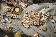 Dietary Cookies with  honey and nuts on napkin and wooden table Royalty Free Stock Images