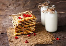 Dietary crunchy cracker with cereals and milk on a dark wooden b Royalty Free Stock Image