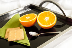 Dietary dessert served to bed. Two orange halves and two bisquits Stock Image