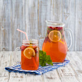 Dietary detox drink with lemon juice, red strawberry and mint leaves in clear water with ice Royalty Free Stock Image