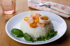 Dietary dish - rice with shrimp, calamari and basil.  royalty free stock photography