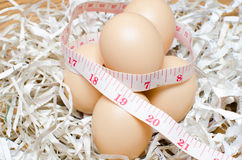 Dietary with egg. Egg with tape measure Stock Photos