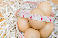 Dietary with egg. Egg with tape measure Stock Photo