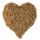 Dietary Fiber for Heart Health. Bran in a heart shape, isolated on white. Dietary fiber is beneficial for heart health stock photography