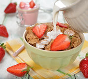 Dietary flakes with strawberries and milk Stock Photography