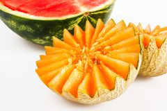 Dietary food, detox. Cut yellow melon and red watermelon on a white background royalty free stock photos