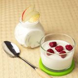 Dietary food. Natural home dairy product. Fruit yogurt with fresh pear and raspberries. royalty free stock images