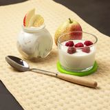 Dietary food. Natural home dairy product. Fruit yogurt with fresh pear and raspberries. stock image