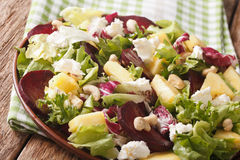 Dietary food: salad of beets, pineapple, cream cheese and greens Royalty Free Stock Photo