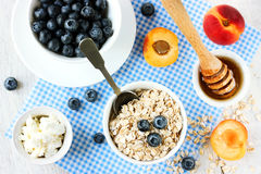 Dietary food for weight loss - oatmeal, berries, fruits, honey, Royalty Free Stock Photo
