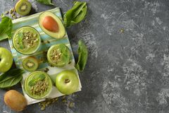 Dietary green smoothies. On a gray background royalty free stock image