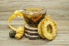 Dietary jasmine tea and dried pineapple Stock Photo