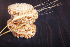 Dietary a low caloric grain crackers. On a dark wooden background stock images