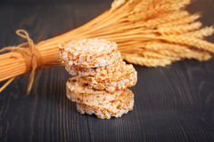 Dietary a low caloric grain crackers. Dietary a low caloric grain crackers on a dark wooden background royalty free stock photos