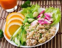 Dietary menu. Breakfast. Oatmeal porridge with vegetables. Stock Photos