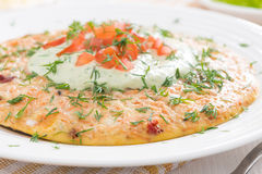 Dietary omelette with carrots, tomatoes and green yogurt sauce Stock Photos