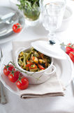 Dietary pasta with spinach, zucchini and cherry tomatoes Royalty Free Stock Photos