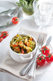 Dietary pasta with spinach, zucchini and cherry tomatoes Royalty Free Stock Image
