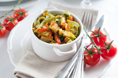 Dietary pasta with spinach, zucchini and cherry tomatoes Royalty Free Stock Images
