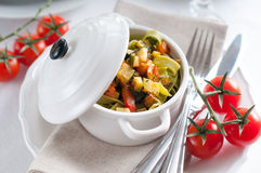 Dietary pasta with spinach, zucchini and cherry tomatoes Stock Image