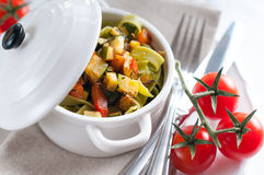 Dietary pasta with spinach, zucchini and cherry tomatoes Royalty Free Stock Photo