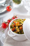 Dietary pasta with spinach, zucchini and cherry tomatoes Royalty Free Stock Photography