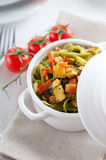 Dietary pasta with spinach, zucchini and cherry tomatoes Stock Photos