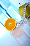 Dietary products. Orange and green apple with measure tape Stock Photo
