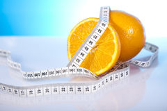 Dietary products. Two oranges with measure tape Royalty Free Stock Images