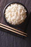 Dietary rice in a black bowl close-up vertical top view Royalty Free Stock Photo