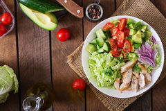 Dietary salad with chicken, avocado, cucumber, tomato and Chinese cabbage. Stock Photo