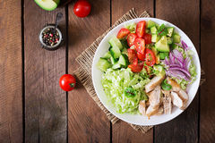 Dietary salad with chicken, avocado, cucumber, tomato and Chinese cabbage. Royalty Free Stock Photos