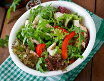Dietary salad with chicken, cheese feta arugula. And sweet red pepper stock photography