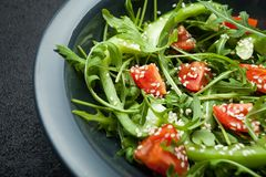 Dietary salad with fresh vegetables tomatoes, arugula, paprika and sesame.  stock photography