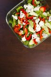 Dietary salad from nutritious vegetables - low-calorie and healt. A nutritious low-calorie salad made from freshly sliced vegetables, consisting of cucumbers Stock Photos