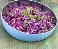 Dietary salad. From red cabbage in a bowl on a wooden boards background. soft focus stock images