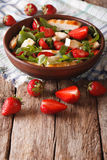 Dietary salad with strawberries, grilled chicken, brie and arugu Royalty Free Stock Image