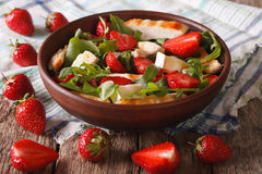 Dietary salad with strawberries, grilled chicken, brie and arugula Stock Photography